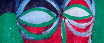 Abstract painting. Image detail: 2 face by bill bissett. Close-up red face, its eyes are blank white ovals heavily outlined in dark green lines. Links to an article by Andrew McEwan.