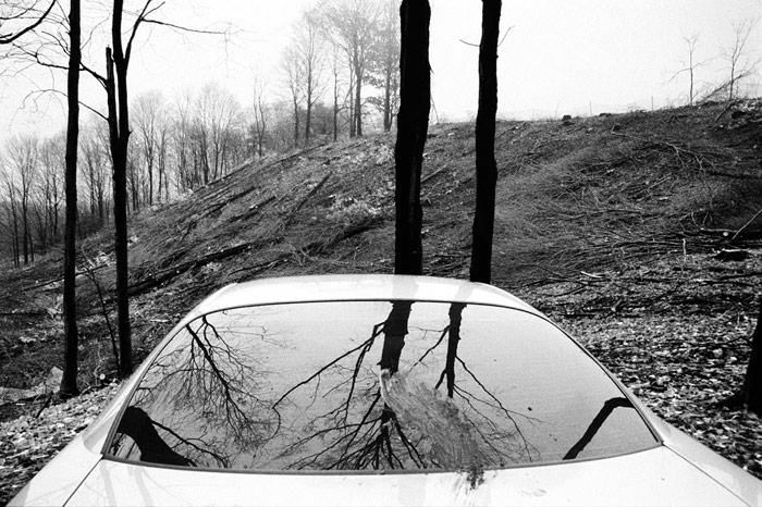 Peter Karuna - Mud-smeared Security Car, Red Hill Valley, 2003